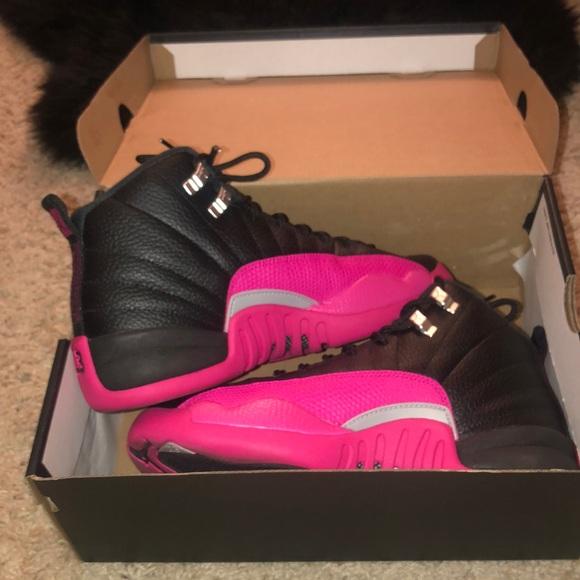 pink and black jordan retro 12s